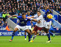 Burnley's Danny Ings goes down inside the penalty area under a challenge from Leicester City's Liam Moore (left), but his appeals for a penalty were turned down<br /> <br /> Photo by Chris Vaughan/CameraSport<br /> <br /> Football - The Football League Sky Bet Championship - Leicester City v Burnley - Saturday 14th December 2013 - King Power Stadium - Leicester<br /> <br /> © CameraSport - 43 Linden Ave. Countesthorpe. Leicester. England. LE8 5PG - Tel: +44 (0) 116 277 4147 - admin@camerasport.com - www.camerasport.com