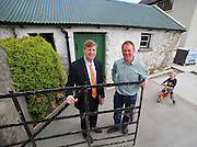 """26/05/2013. Free To Use Image. Patrick Kennedy launches official Kennedy Homestead website and brochure. Pictured at the Kennedy Ancestral Home, Kennedy Homestead, Dunganstown, New Ross, Co. Wexford is Patrick Kennedy, son of the late Senator Ted Kennedy and a former member of the United States House of Representatives with Patrick Grennan, third cousin of President John F. Kennedy, also in photo is Patrick Grennan's son Eanna. Picture: Patrick Browne<br />  <br /> 26 May 2013, New Ross, Wexford: Today marked the official launch of the Kennedy Homestead website and brochure with an American brunch to celebrate the occasion, attended by special guest Patrick Kennedy, son of the late Senator Ted Kennedy and himself a former member of the United States House of Representatives.<br />  <br /> The Kennedy Homestead is a new visitor attraction and exhibition centre, currently finishing construction, which is situated beside the original farm house at Dunganstown where President John F. Kennedy's great grandfather, also named Patrick Kennedy, was born and lived before he emigrated to the United States from the Quayside of New Ross in 1948.<br />  <br /> It was also the location for President John F. Kennedy's iconic visit to have tea with his Irish relatives during his state visit to Ireland in 1963. The interpretative exhibit explores the circumstances of Patrick Kennedy's departure from Ireland in 1848 and pieces together the story of the most famous Irish-American family through the 20th century and on to the present day. The new Kennedy Homestead Visitor Centre will be opened on the 22nd June next by Caroline Kennedy and Taoiseach Enda Kenny to mark the 50th Anniversary of President Kennedy's visit.<br />  <br /> Speaking at the launch of the Kennedy Homestead website and brochure, Patrick Kennedy stated, """"It is a truly celebratory occasion to be here today. We are delighted with the fantastic new Kennedy Homestead website and brochure. The Kennedy Homestead contains s"""