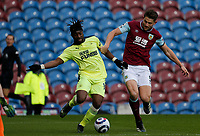 Football - 2020 / 2021 Premier League - Burnley vs. Newcastle United<br /> <br /> Allan Saint-Maximin of Newcastle United breaks through past James Tarkowski of Burnley as he tries to add to his winning goal, at Turf Moor.<br /> <br /> <br /> COLORSPORT/ALAN MARTIN