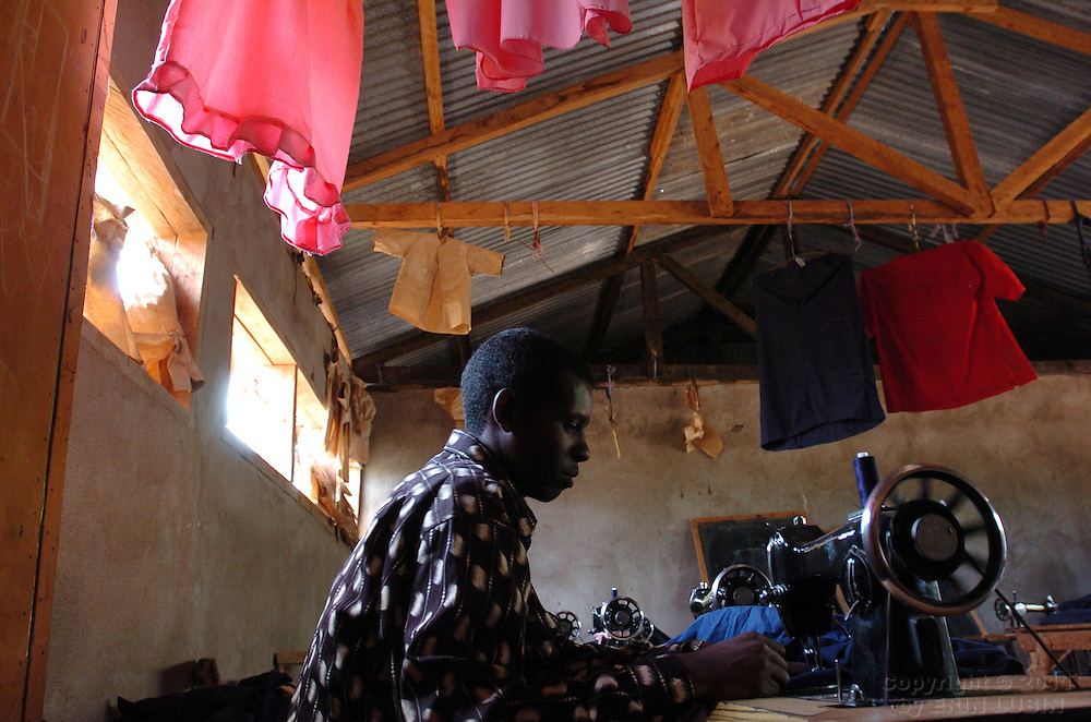 Tailoring student, Hassan Bishar Adan, 25, works at a sawing machine at the Tailoring School in Dagahaley Refugee Camp, Dadaab, Kenya September 15, 2006. ..Photograph by Erin Lubin