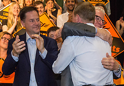 © Licensed to London News Pictures. 16/07/2015. London, UK. Nick Clegg watches as Norman Lamb greets Tim Farron at Islington Assembly Hall for Tim Farron's first rally as Leader of the Liberal Democrats after beating Norman Lamb in the contest to succeed Nick Clegg. Photo credit : James Gourley/LNP