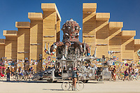 The Temple of Direction (and El Pulpo Mechanico)<br /> by: Geordie Van Der Bosch<br /> from: San Francisco, CA<br /> year: 2019<br /> <br /> The Temple of Direction is organized linearly. It recreates a restricted passage which expands in the center into a large hall. This is a response to the openness of the playa; it creates a space traveled end to end; versus wandering an open plan; this temple provides direction and focus. Linearity also reflects the passage of life; all lives have a beginning, a middle and an end which metaphorically is included in this temple's form. Following this metaphor a variety of spaces are created; narrow spaces and wide spaces, dark spaces and bright spaces. Tunnels create intimate experiences with shade.. A large central hall expands in width and height providing a bright area suitable for gatherings.<br /> <br /> URL: https://www.templeofdirection.org<br /> Contact: templeofdirection@gmail.com<br /> <br /> https://burningman.org/event/brc/2019-art-installations/?yyyy=&artType=H#a2I0V00000167U9UAI