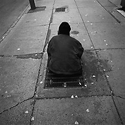 A man who is only known as Brian sitting on a grate which is the exhaust vent for an office tower on Adelaide Street West located in Toronto's Financial District. Brian has been living on this grate for several years..(Credit Image: © Louie Palu/ZUMA Press)