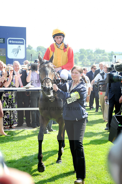 Winner of the 2010 Investec Oaks Snow Fairy ridden by  jockey RYAN MOORE at the Investec Ladies Day at Epsom Racecourse, Surrey on 4th June 2010.