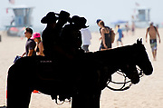 Police keep eyes on the crowd at the US Open of Surfing in Huntington Beach, California.