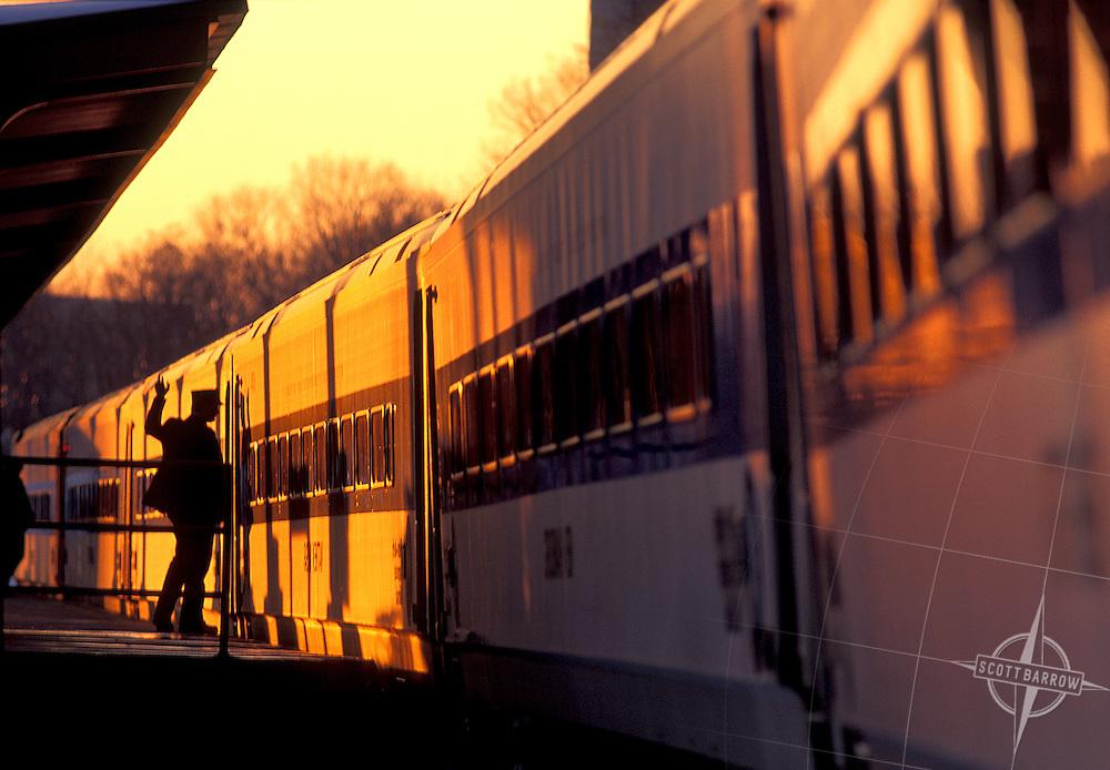 Conductor on platform boarding train.