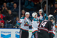KELOWNA, CANADA - NOVEMBER 11: Kole Lind #16 and Nolan Foote #29 celebrate the first goal of the season for Braydyn Chizen #22 of the Kelowna Rockets against the Red Deer Rebels on November 11, 2017 at Prospera Place in Kelowna, British Columbia, Canada.  (Photo by Marissa Baecker/Shoot the Breeze)  *** Local Caption ***