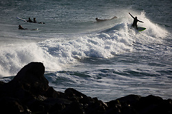 © Licensed to London News Pictures. 12/12/2020. St Ives, UK. Surfers catch waves at sunrise in St Ives, Cornwall. Photo credit : Tom Nicholson/LNP