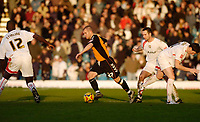 Photo: Leigh Quinnell.<br /> Milton Keynes Dons v Barnet. Coca Cola League 2. 20/01/2007. Barnets Adam Birchall looks for a way past MK Dons Jude Stirling.