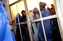 BAHARAK HOSPITAL, 28 July 2005..Young mothers wait outside the vaccination clinic...The clinic provides children immunization against Tetanus, Polio, Thubercolosi and Diphtheria...The clinic is supported by the United Nations Population Fund.....According to UNFPA data, Afghanistan has among the world?s highest rates of maternal mortality, and Badakhshan has the highest rates ever recorded anywhere in the world, with one mother dying in every 15 births. Underage marriage is one of the primary causes of maternal mortality...