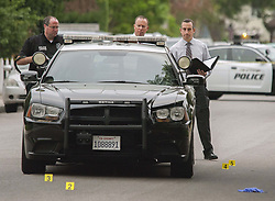 August 21, 2017 - Orange, CA, USA - Investigators looks at the scene where a shooting turned deadly in Orange, CA early Monday morning, August 21, 2017. (Credit Image: © Ken Steinhardt/The Orange County Register via ZUMA Wire)