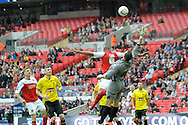 Fleetwood Town's  Antoni Sarcevic free kick deflects off Fleetwood Town's Steven Schumacher and over Burton Albion's goalkeeper Dean Lyness to score  take Fleetwood 1-0.  Skybet football league two play off final match , Burton Albion v Fleetwood Town at Wembley Stadium in  London on Monday 26th May 2014.<br /> pic by John Patrick Fletcher, Andrew Orchard sports photography.