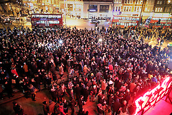 © Licensed to London News Pictures. 11/01/2016. London, UK. A crowd gather outside the Ritzy cinema in Brixton in tribute to David Bowie. The Death of David Bowie, who was born in Brixton, has been announced today.  Photo credit: Peter Macdiarmid/LNP