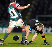 Wycombe. GREAT BRITAIN, 5th December 2004. Heineken Cup Rugby  London Wasps and Leicester Tigers,  Adams Park, ENGLAND, [Mandatory Credit; Peter Spurrier/Intersport-images].<br /> <br /> Tigers Harry Ellis, kicks the ball out of Matt Dawsons hands.