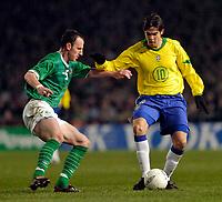 Photo. Jed Wee.<br /> Republic of Ireland v Brazil, International Friendly, Lansdowne Road, Dublin. 18/02/2004.<br /> Ireland's Andy O'Brien (L) tries to stop Brazil's Kaka.