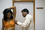 An actress is pinned into her costume backstage at rehearsals for the Merchants of Bollywood in the Yash Raj Studios in Mumbai (Bombay), India<br /> <br /> The Merchants of Bollywood, An Indian theatrical dance musical, charts the history of the world's largest and most prolific film industry, and is loosely based on the showbusiness, Merchant family. Seen by over two million people worldwide, the show is homage to the world of Indian cinema.