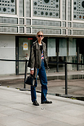 Street style, Hilda Sandstrom arriving at Ludovic de Saint Sernin Spring Summer 2022 show, held at Institut du Monde Arabe, Paris, France, on Ocotber 3rd, 2021. Photo by Marie-Paola Bertrand-Hillion/ABACAPRESS.COM