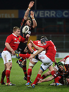 Brook Harris of the Dragons tries to charge down Duncan Williams of Munster .<br /> Guinness Pro12 rugby match, Munster v Newport Gwent Dragons at Thomond Park in Limerick , Ireland on Saturday 5th March 2016.<br /> pic by  John Halas, Andrew Orchard sports photography.