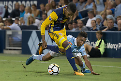 September 20, 2017 - Kansas City, Kansas, U.S - Sequence 03-02: NY Red Bulls defender Michael Amir Murillo #62 (l) pushes against Sporting KC forward Latif Blessing #9 (r), resulting in a fall during the first half of the game. No foul is called. Sporting KC will win the 2017 Lamar Hunt Open Cup championship with a score of 2-1 over the New York Red Bulls. (Credit Image: © Serena S.Y. Hsu via ZUMA Wire)