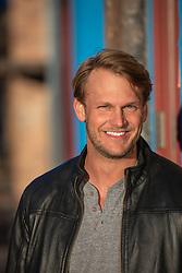 blond hair blue eyed man smiling