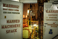 The entrance to the engine room displays warning signs on board the Alfa K, a Mediterranean based bulk carrier with a Panamanian flag, which was undergoing repairs at the port of Piraeus in Greece on Feb. 20, 2008. Inspectors impose ITF-standard treaties on ship-owners to guarantee minimal standard working conditions for seafarers. They are on call 24 hours a day to address concerns from workers coming to port on the international ships.