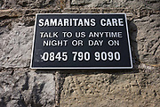 A Samaritans suicide 0845 helpline sign on Brunel's Clifton suspension bridge in Bristol. Samaritans is a confidential emotional support service for anyone in the UK and Ireland. The service is available 24 hours a day for people who are experiencing feelings of distress or despair, including those that may lead to suicide. Across the UK, one can call Samaritans on 08457 90 90 90 for the price of a local call. Samaritans was founded in 1953 by Chad Varah, a vicar in the London Diocese. His inspiration came from an experience he had had some years earlier as a young curate in the Diocese of Lincoln. He had taken a funeral for a girl of fourteen who had killed herself because she feared she had contracted an STI. The movement grew rapidly and within ten years there were 40 branches and there are now 201 branches across the UK and Ireland.