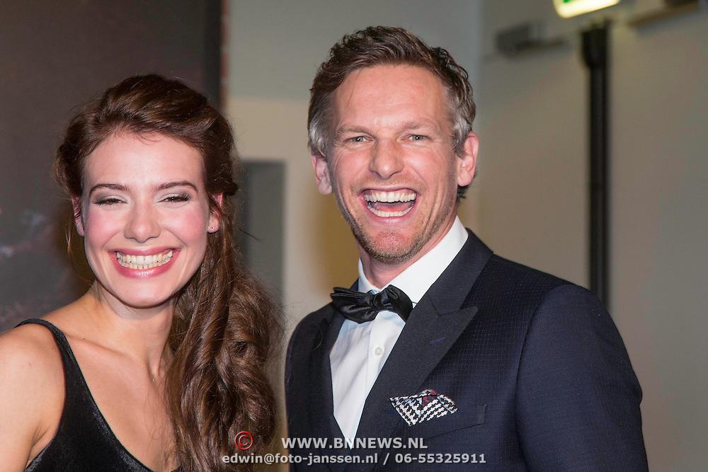 NLD/Haarlem/20140324 - Filmpremiere Kenau, Actrice Sallie Harmsen (Kathelijne, de overgebleven dochter van Kenau) en acteur Barry Atsma (Wigbold Ripperda)