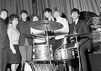 The Beatles posing for photographs with fans before their show at the Adelphi Theatre in Dublin in 1963.<br /> <br /> (Part of the Independent Newspapers Ireland/NLI collection.)