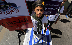 June 23, 2017 - Gaza City, Gaza Strip - Palestinian Scout youths hold placards and step on the Israeli flag in a protest marking the annual al-Quds Day, or Jerusalem Day, following Friday prayer in Gaza. (Credit Image: © Ashraf Amra/APA Images via ZUMA Wire)