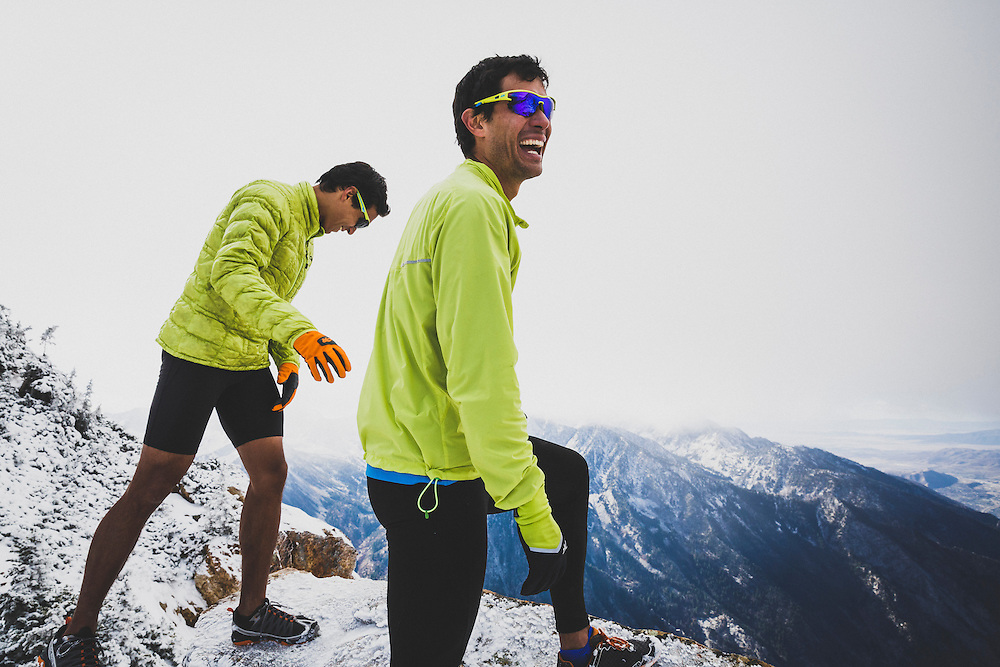 Brothers Jason and Andy Dorais take the views from the east ridge of Salt Lake Twin Peaks after an early season coat of snow has fallen in the Wasatch Mountains, Utah.