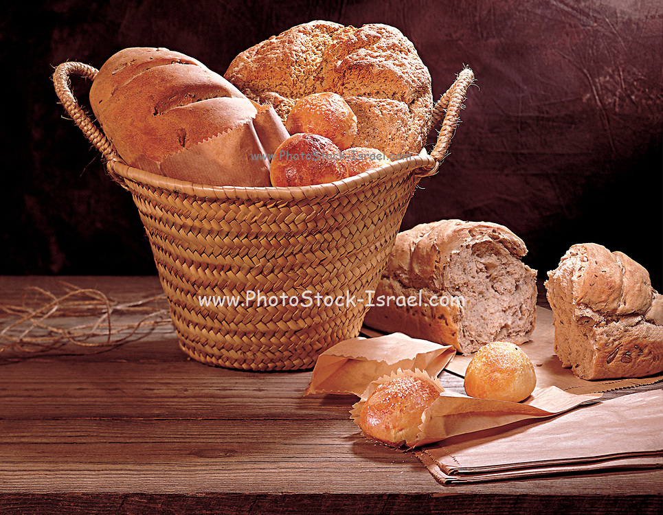 Various types of freshly backed bread and rolls including wholewheat, rye and Challah
