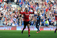 Cardiff city's Peter Odemwingie © celebrates after he scores his sides goal to make it 1-2.Barclays Premier League match, Cardiff city v Newcastle Utd  at the Cardiff city stadium in Cardiff, South Wales on Saturday 5th Oct 2013. pic by Andrew Orchard, Andrew Orchard sports photography,