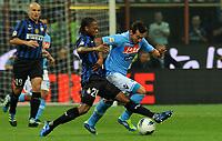 """Joel OBI (Inter), Ezequiel LAVEZZI (Napoli)<br /> Milano 1/10/2011 Stadio """"Giuseppe Meazza""""<br /> Serie A 2011/2012<br /> Football Calcio Inter Vs Napoli<br /> Foto Insidefoto Alessandro Sabattini"""