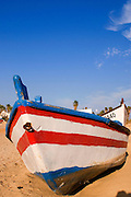 Israel, Beached fishing boat on the shores of the Mediterranean sea at low tide