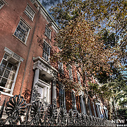 Old residential real estate still standing amid the largesse of Manhattan