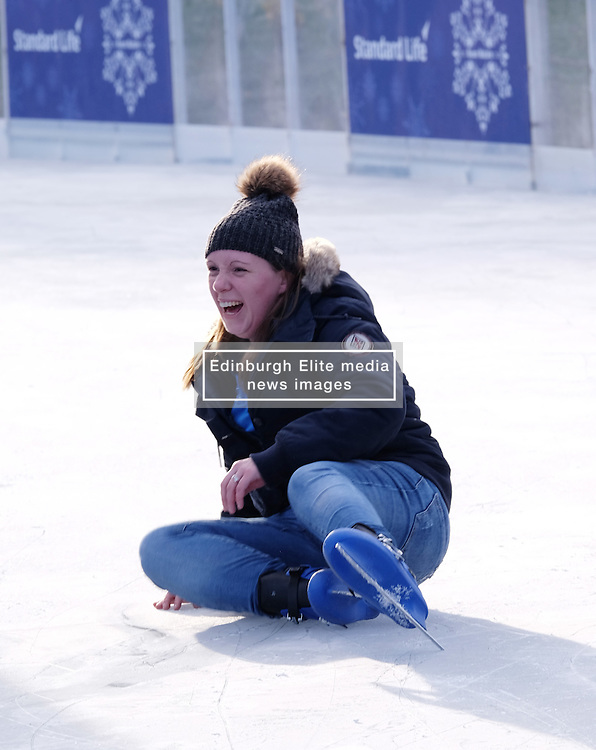 Edinburgh's Christmas 2016, Friday 18th November 2016<br /> <br /> The Edinburgh's Christmas Ice Rink in St Andrew's Square opened to the public today.<br /> <br /> A skating elf takes to the ice to help learners, young and old alike.<br /> <br /> (c) Alex Todd   Edinburgh Elite media