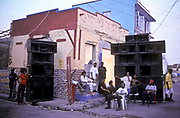 After an all night street Dancehall event in downtown Kingston, the few remaining men and women chill out before heading for home, seen hanging around the gigantic sound systems. Jamaica