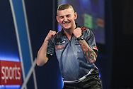 Nathan Aspinall wins the match against Geert Nentjes and celebrates during the World Darts Championships 2018 at Alexandra Palace, London, United Kingdom on 19 December 2018.