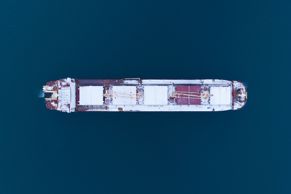 Top down aerial view of the bulk carrier 'Nautical Loredana' at anchor in the port of Narvik in Northern Norway.