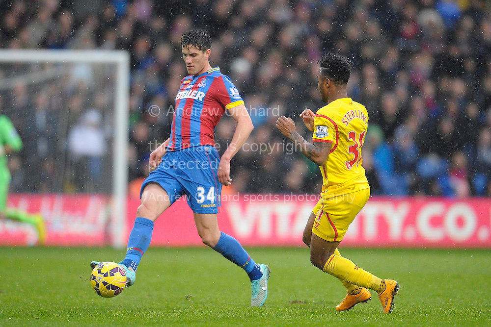 Martin Kelly of Crystal Palace passing the ball past Raheem Sterling of Liverpool. Barclays Premier league match, Crystal Palace v Liverpool at Selhurst Park in London on Sunday 23rd November 2014.<br /> pic by John Patrick Fletcher, Andrew Orchard sports photography.