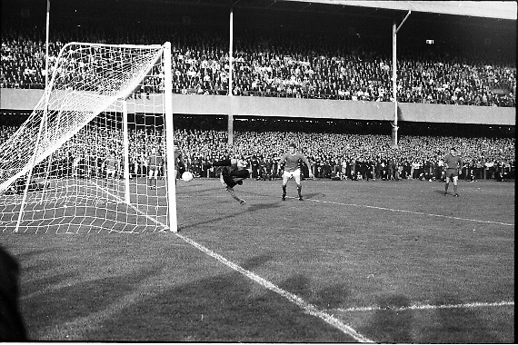 Waterford FC vs Manchester United at Lansdowne Road..1968..18.09.1968..09.18.1968..18th September 1968..Waterford FC as champions of the league of Ireland drew Manchester United, the European Champions,in the first round of this years competition.The Waterford team was as follows: Peter Thomas, Peter Bryan, Noel Griffin, Vinny Maguire, Jackie Morley, Jimmy McGeough, Al Casey, Alfie Hale, John O'Neill, Shamie Coad and Johnny Matthews. Manchester United won the tie 3 -1 with Denis Law being the man of the match..Alex Stepney,Tony Dunne,Francis Burns,Paddy Crerand,.Bill Foulkes,Nobby Stiles,George Best,Denis Law,.Bobby Charlton,David Sadler,Brian Kidd were the starting eleven for United...A full length dive from keeper Peter Thomas cannot stop Denis Law scoring his second goal of the game.