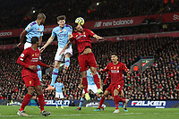 Football - 2019 / 2020 Premier League - Liverpool vs. Manchester City<br /> <br /> John Stones of Manchester City competes with Dejan Lovren of Liverpool, at Anfield.<br /> <br /> COLORSPORT/PAUL GREENWOOD