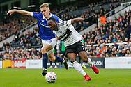 Oldham Athletic defender Tom Hamer (34) battles for possession with Fulham midfielder Neeskens Kebano (7) during The FA Cup 3rd round match between Fulham and Oldham Athletic at Craven Cottage, London, England on 6 January 2019.