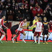 Felipe Martins, (center), New York Red Bulls, is congratulated by team mates after scoring the first of his two spectacular goals in New York Red Bulls 4-3 win during the New York Red Bulls Vs Houston Dynamo, Major League Soccer regular season match at Red Bull Arena, Harrison, New Jersey. USA. 19th March 2016. Photo Tim Clayton