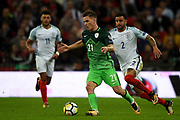 Slovenia midfielder Benjamin Verbic  pressured by England defender Kyle Walker during the FIFA World Cup Qualifier match between England and Slovenia at Wembley Stadium, London, England on 5 October 2017. Photo by Martin Cole.