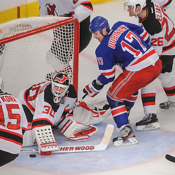 New Jersey Devils goalie Martin Brodeur (30) denies New York Rangers left wing Brandon Dubinsky's (17) scoring chance during third period NHL action between the New Jersey Devils and the New York Rangers at Madison Square Garden in New York, N.Y. The Rangers defeated the Devils 4-2.