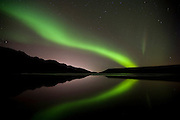 Symmetric Aurora Borealis over lake Kleifarvatn, south-west Iceland