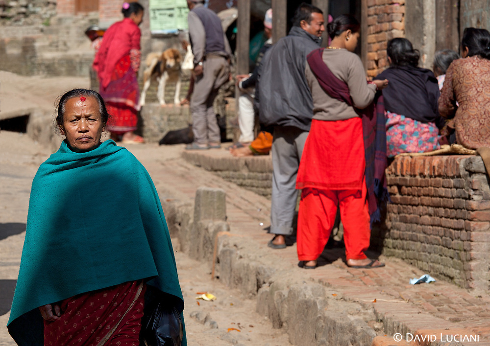 """A street between Taumadhi Square and Khalna Tole Square. Bhaktapur also called Bhadgaon, which means """"City of Rice"""" is listed as a World Heritage Site by the UNESCO since 1979."""