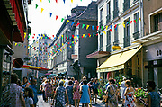 Shopping street crowded with people in town centre of Troyes, France 1976