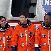 The crew of space shuttle Discovery, from left, mission specialist's Nicole Stott, Michael Barratt and  Alvin Drew smile before boarding their transport vehicle before Discovery's final launch at the Kennedy Space Center in Cape Canaveral, Fla., Thursday, Feb. 24, 2011. (AP Photo/Alex Menendez)